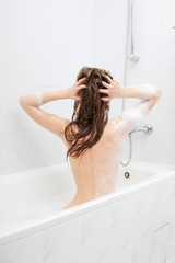 Woman relaxing in a bath
