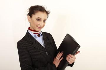Junge Geschäftsfrau mit einer Mappe