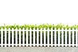 white picket fence strip with green garden bushes - 26600975