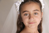 Close up of girl dressed for her first communion