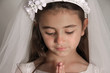Girl in veil praying