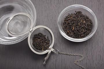 Still life with black tea leaves