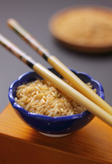 Brown rice in bowl with chopsticks