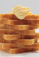 Piled toast bread slices with butter