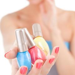 Elegant woman choose the color of nail polish