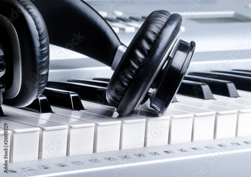 Poster Headphones on keyboard
