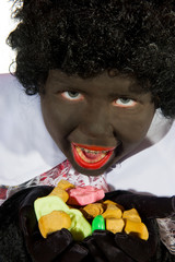 Black Piet is eating pepernoten