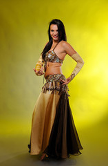 Beautiful sexy dancer woman in bellydance costume with pretty pr