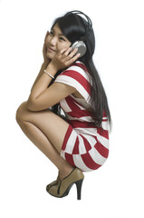 Sexy young Asian girl listening to music