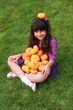 Indian girl with pumpkins