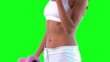 Close-up of a woman training with dumbbells against green screen