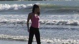 Attractive woman doing fitness on the beach