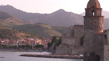 View of a city and historic monument by the sea