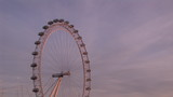 Focus on the London eye at sunset