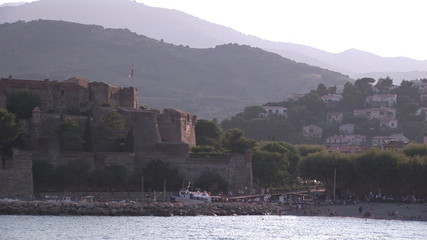 View of a harbour and castle with visitors