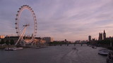 View of London eye and Thames at sunset