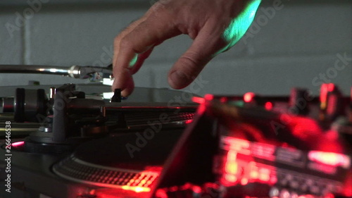 Dj scratching a record during a party