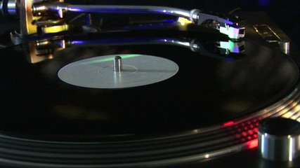 Close up of a disk recording on a turntable during a party