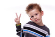 Cute young boy holding up the peace sign