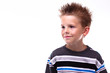 Cute young boy smiling looking off camera