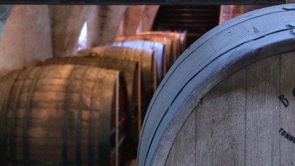 Close up of a corridor full of wine barrels