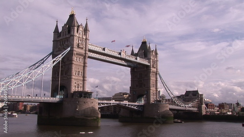 Side view of London bridge with traffic at day