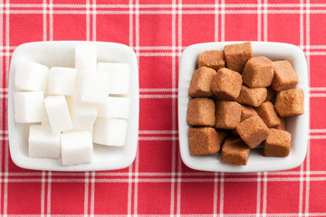 brown and white cubes of sugar