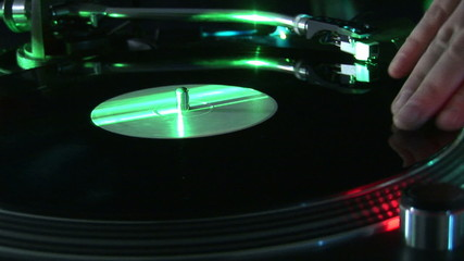 Close-up of a turntable during a party in a nightclub