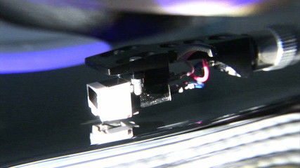 Close up of a record turning on a dj's turntable during party