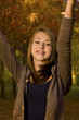 Teen Girl  -  Tossing Fall Leaves