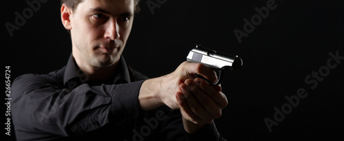 photo yuong man with gun