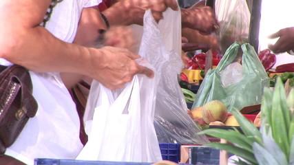 Close up of customers in front of fruits display in a market