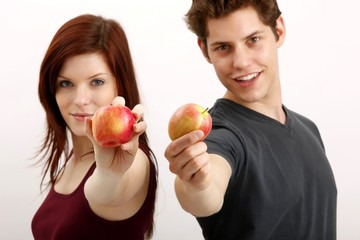 young couple with apples (focus on apples)