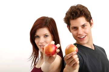 young couple with apples (focus on faces)