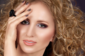 beautiful blond woman with long curly hair and smoky eyeshadow
