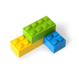 Yellow, green and blue lego blocks assembled together poster