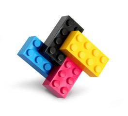 Lego blocks of four process colors cyan magenta yellow black