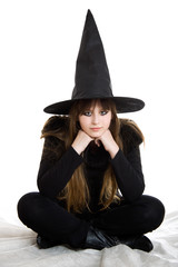 Child girl in Halloween witch