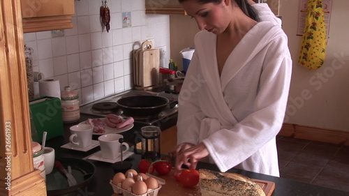Young couple preparing lunch in bathrobe at home