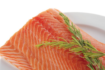 raw salmon fillet on white and rosemary