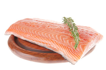 fresh uncooked salmon fillet on wooden plate