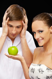 young couple with apple