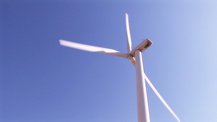 Rear view of a wind turbine in activity