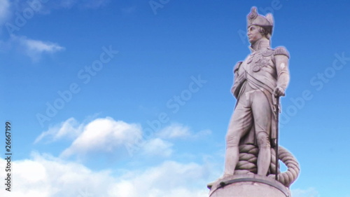 Statue of a commander with blue sky in slow motion