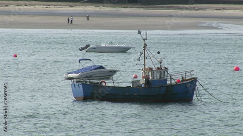 Fishing boat and motor boats in the sea