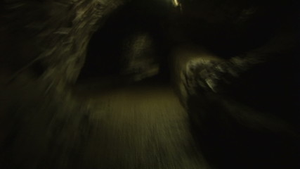 Vision of a man running in a dark cave