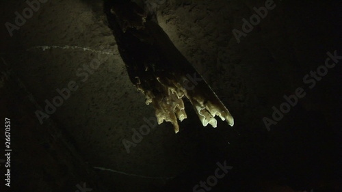 Stalactite lighting up in a cave