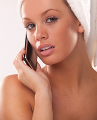 woman after bath using her mobile phone