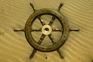 boat wheel on sand
