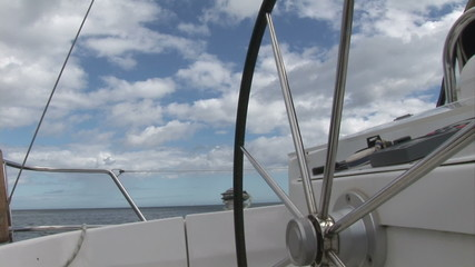 Front view of a boat wheel sailing in the open sea